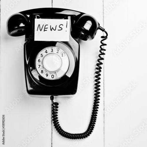 Retro black phone with news message