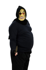 Maniac in a mask threatens with a knife