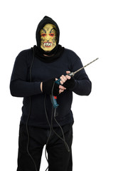 Maniac in a mask threatens with big drill