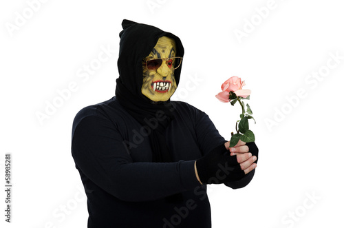 Glasses monster holds pink rose
