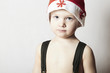 modest little boy in Santa hat. Christmas.
