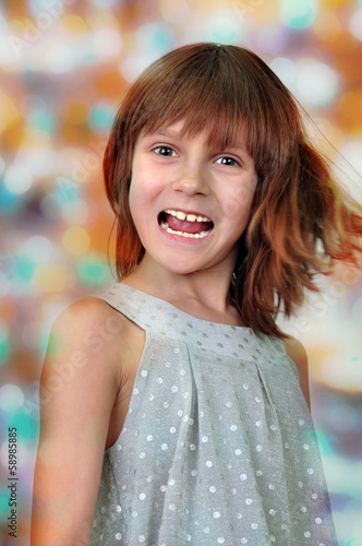 holiday portrait of happy child against bright background