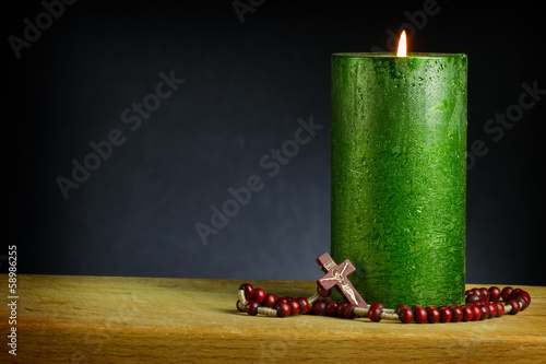 candle with wooden cross