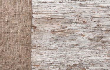 Old wood bordered by burlap
