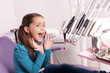 little girl is afraid of the dentist tools
