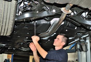 Mechanic under car.
