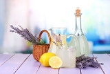 Lavender lemonade in glass bottle and jug,