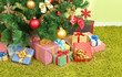 Decorated Christmas tree with gifts close-up