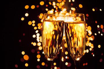 champagne glass against christmas sparkler background