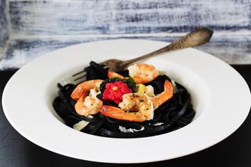 Italian dish - fettuccine with shrimps and caviar