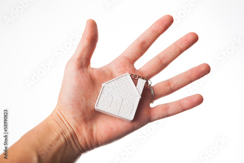 hand with house keychain