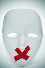mask with its mouth shut with red tape