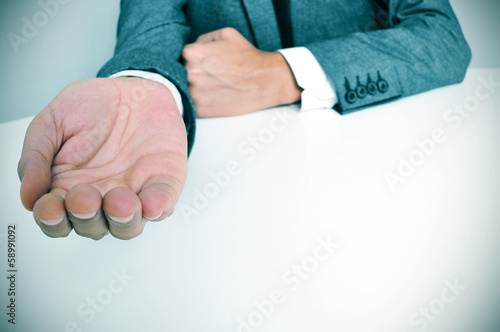 man in suit with an outstretched hand