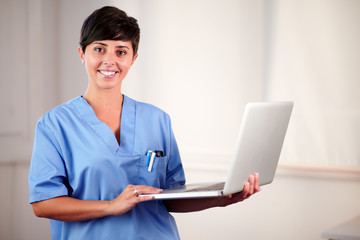 Female latin doctor working on her laptop