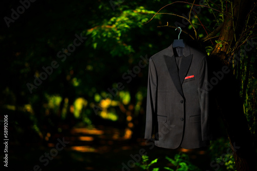 Groom tuxedo hanged in a tree, nature