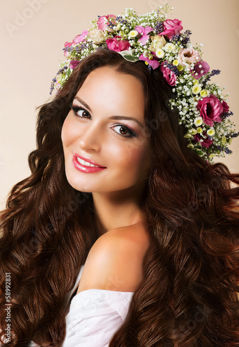 Genuine Woman with Flowing Healthy Hairs and Wreath of Flowers