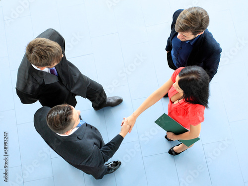 Full length image of business men shaking hands with each other