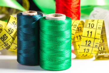 Spools of thread and measuring tape