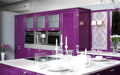 modern purple kitchen with stylish furniture