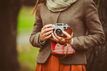 Vintage camera in the hands of the girl