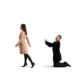 man bending the knee before woman