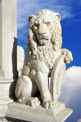 statue of lion on a background of blue sky