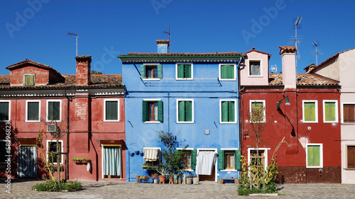colored facade of the island of Burano in the background of blue