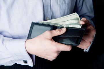 money in the hands of men. purse