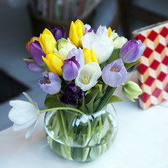 colourful tulips in glass vase for sale