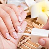 Fototapety Woman in a nail salon receiving manicure