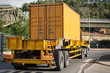 yellow container on truck
