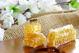 natural organic sweet honeycomb on a wooden plate