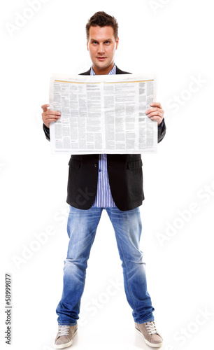 Businessman reading a newspaper isolated