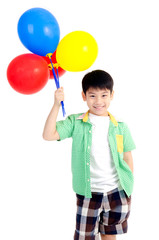 Happy asian cute boy with colorful balloons