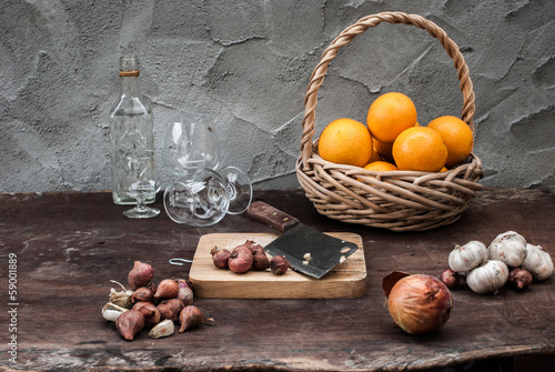 Shallots , Onion , Garlic , Chopping board , Knife , Orange with