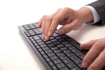 Fingers typing computer keyboard