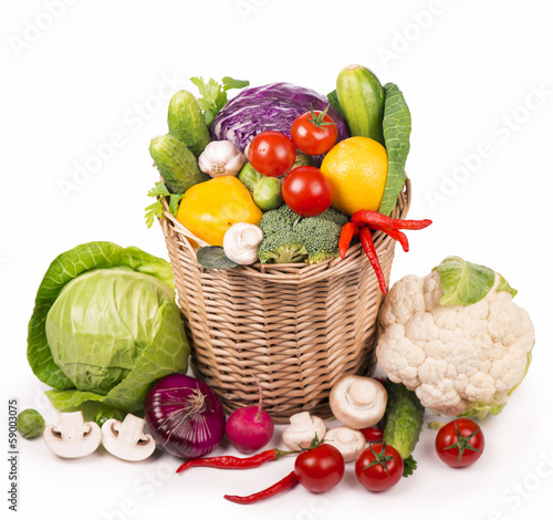 Fruits and vegetables in the basket close up