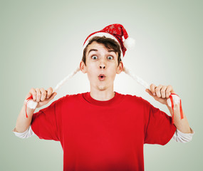 Young man in funny santa hat with pigtails