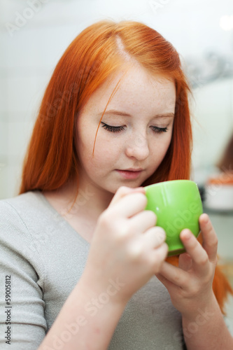 girl gargling throat in  home