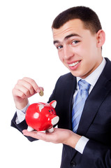 Man with piggybank isolated on white