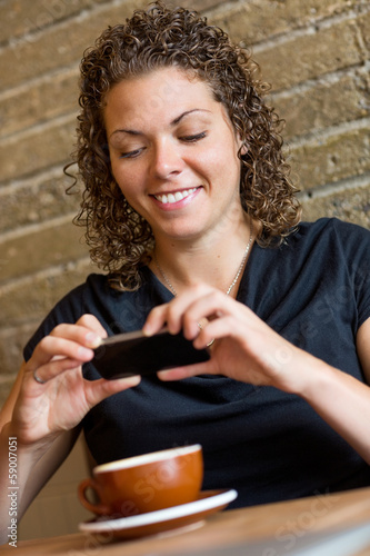 Woman Photographing Coffee In Cafeteria
