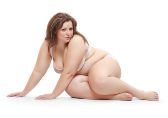 Overweight woman dressed in underwear isolated on a white.