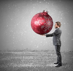 Businessman with big Christmas ball