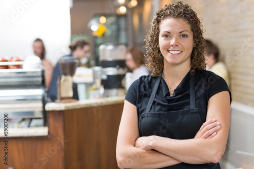 Happy Owner Standing Arms Crossed In cafe