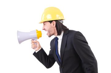 Man with helmet and loudspeaker on white