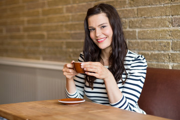 Woman in Coffee Shop Holding Cup