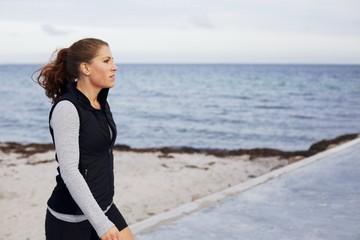 Pretty caucasian woman taking a break from running