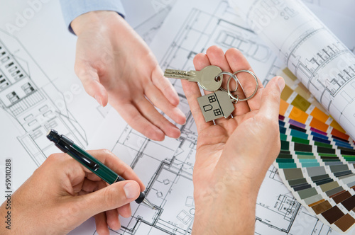 Architect Handing Keys
