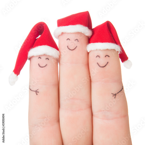 Fingers faces in Santa hats. Happy family celebrating concept fo