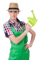 Young woman with watering can on white